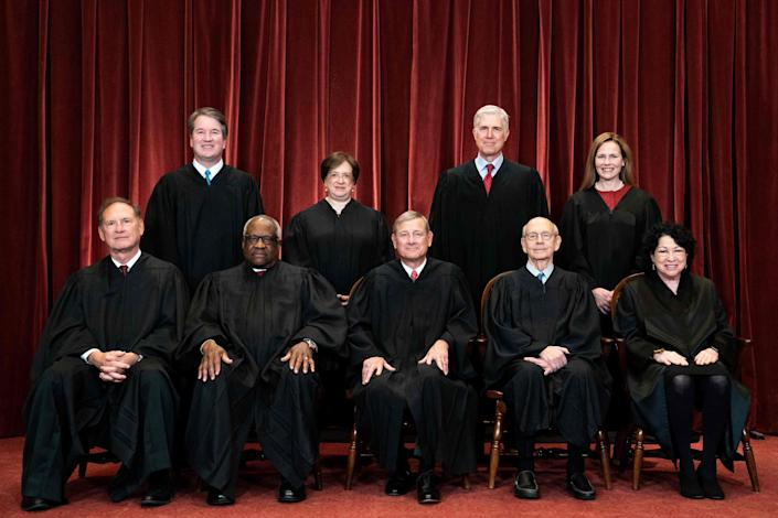 From left, Justices Samuel Alito, Brett Kavanaugh, Clarence Thomas, Elena Kagan, Chief Justice John Roberts, Justices Neil Gorsuch, Stephen Breyer, Amy Coney Barrett and Sonia Sotomayor.