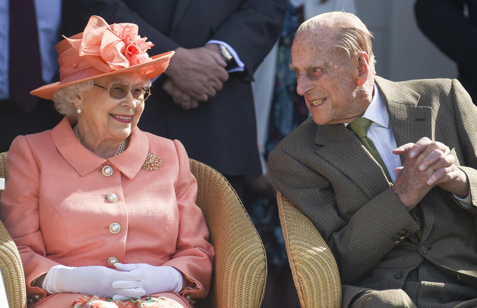 Prince Philip leans in to speak to the Queen as they enjoy the Royal Windsor Cup 2018 polo match at Guards Polo Club in June 2018. (Getty)