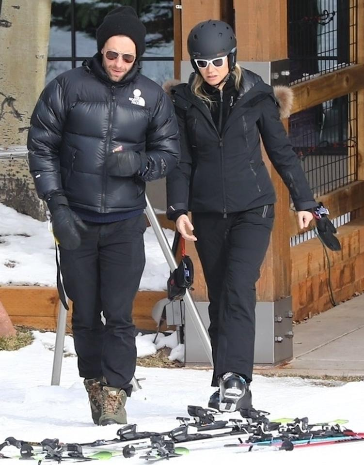 Exes Chris Martin and Gwyneth Paltrow hang out on Monday during a family ski vacation to Aspen, Colorado.