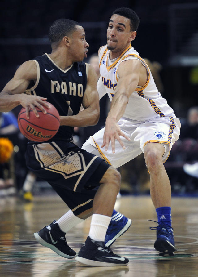 Idaho's Glen Dean, left, is guarded by UMKC's Nelson Kirksey during the first half of an NCAA college basketball game in the first round of the West Athletic Conference men's tournament on Thursday, March 13, 2014, in Las Vegas. (AP Photo/David Becker)