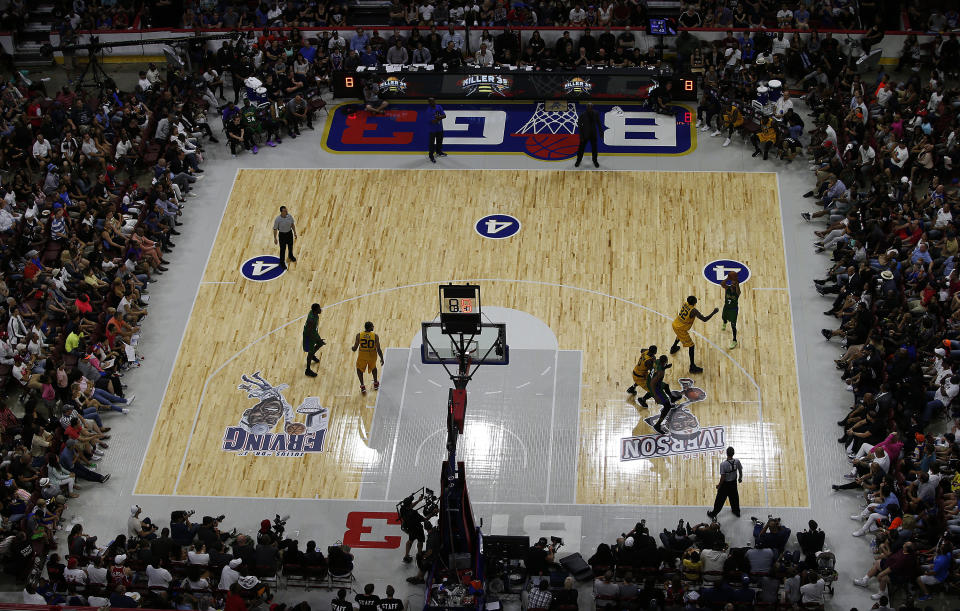 An overhead view of a BIG3 basketball game in 2017. The court is half of a regular basketball court with only three players per team.