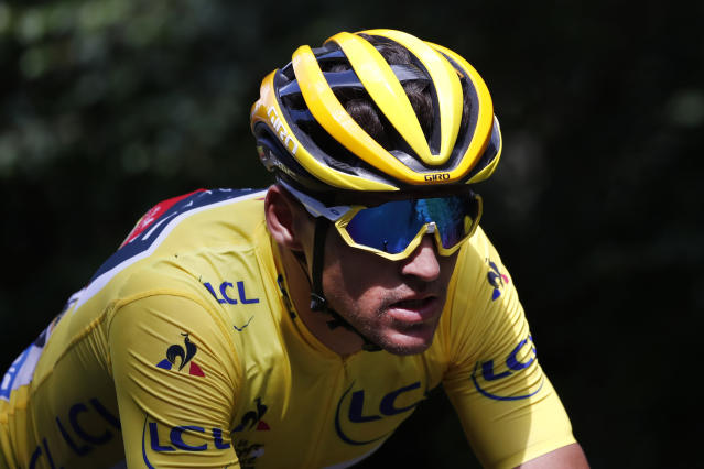 Belgium's Greg van Avermaet, wearing the overall leader's yellow jersey, rides in the pack during the fifth stage of the Tour de France cycling race over 204.5 kilometers (127 miles) with start in Lorient and finish in Quimper, France, Wednesday, July 11, 2018. (AP Photo/Christophe Ena)
