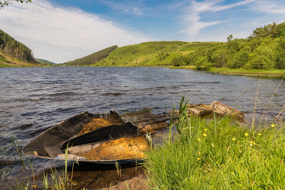 View over Llyn Geirionydd, near Llanwrst, Conwy, Wales, UK - with a damaged boat in the foreground