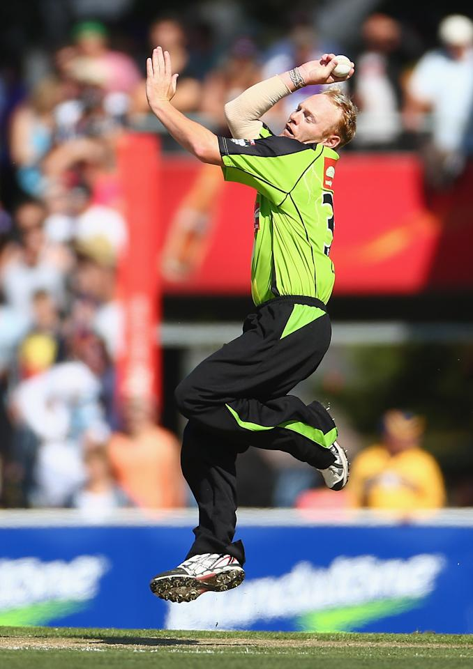 HOBART, AUSTRALIA - DECEMBER 23: Scott Coyte of the Thunder bowls during the Big Bash League match between the Hobart Hurricanes and the Sydney Thunder at Blundstone Arena on December 23, 2012 in Hobart, Australia.  (Photo by Robert Cianflone/Getty Images)