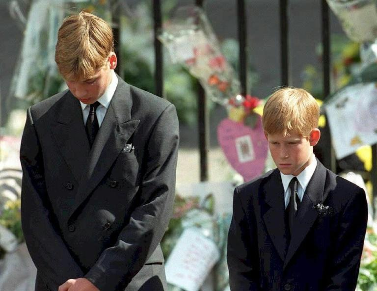 Prince William (left) and Prince Harry bow their heads during the funeral of their mother Diana, Princess of Wales, at Westminster Abbey in 1997