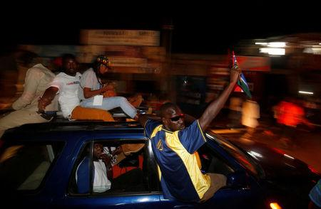 People celebrate the arrival  of Gambia's new President Adama Barrow to the country, at the airport in Serekunda, Gambia January 26, 2017. REUTERS/Thierry Gouegnon