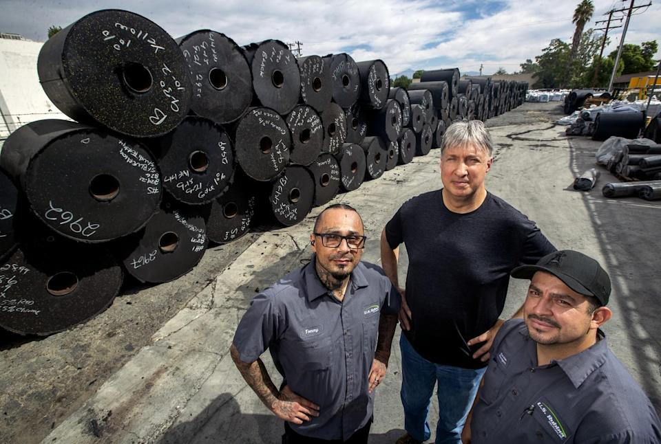 Thomas Urioste, 50, left, and Carlos Arceo, 39, right, former felons and employees at U.S. Rubber Recycling.