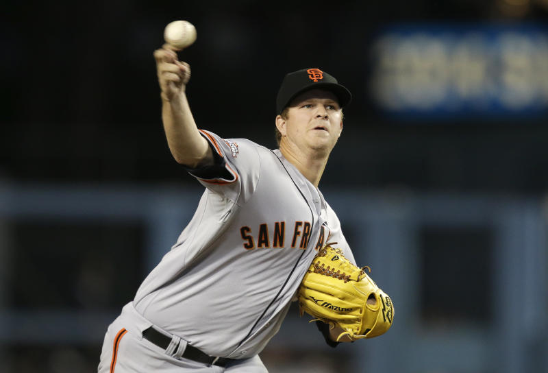 San Francisco Giants starting pitcher Matt Cain throws to a Los Angeles Dodgers batter during the first inning of a baseball game Thursday, Sept. 12, 2013, in Los Angeles. (AP Photo/Jae C. Hong)