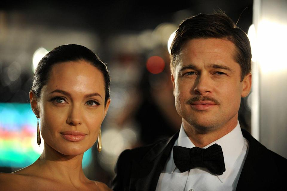 """<p>In 2008, Brad Pitt starred as a man who ages backwards in the film <em><a href=""""https://www.imdb.com/title/tt0421715/?ref_=nm_flmg_act_25"""" rel=""""nofollow noopener"""" target=""""_blank"""" data-ylk=""""slk:The Curious Case of Benjamin Button"""" class=""""link rapid-noclick-resp"""">The Curious Case of Benjamin Button</a></em>. He also had a humorous appearance in The Coen Brother's <em><a href=""""https://www.imdb.com/title/tt0887883/?ref_=nm_flmg_act_26"""" rel=""""nofollow noopener"""" target=""""_blank"""" data-ylk=""""slk:Burn After Reading"""" class=""""link rapid-noclick-resp"""">Burn After Reading</a></em>. Pitt and Jolie welcomed twins Knox Léon and Vivienne Marcheline into the world that summer in France.</p>"""