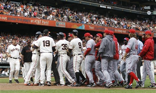 San Francisco Giants and Cincinnati Reds' benches clear after Giants pitcher Ryan Vogelsong was nearly hit by a pitch thrown by Reds' Bronson Arroyo in the sixth inning of a baseball game, Sunday, July 1, 2012, in San Francisco. (AP Photo/Ben Margot)