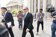 Igor Fruman, center, is surrounded by reporters as he leaves in Federal court in Manhattan with his attorney Todd Blanche, left, Friday, Sept. 10, 2021. The Soviet-born Florida businessman who helped Rudy Giuliani seek damaging information about Joe Biden in Ukraine when Biden was running for president pleaded guilty in a case involving illegal campaign contributions. (AP Photo/Mary Altaffer)