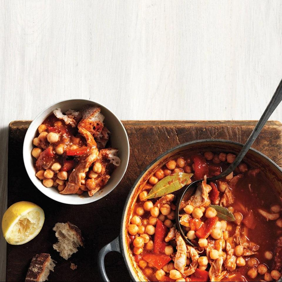 """A couple of chicken thighs amount to a lot of flavor alongside the filling chickpeas and crusty bread in this hearty Lebanese-inspired stew. <a href=""""https://www.epicurious.com/recipes/food/views/chickpea-stew-388656?mbid=synd_yahoo_rss"""" rel=""""nofollow noopener"""" target=""""_blank"""" data-ylk=""""slk:See recipe."""" class=""""link rapid-noclick-resp"""">See recipe.</a>"""