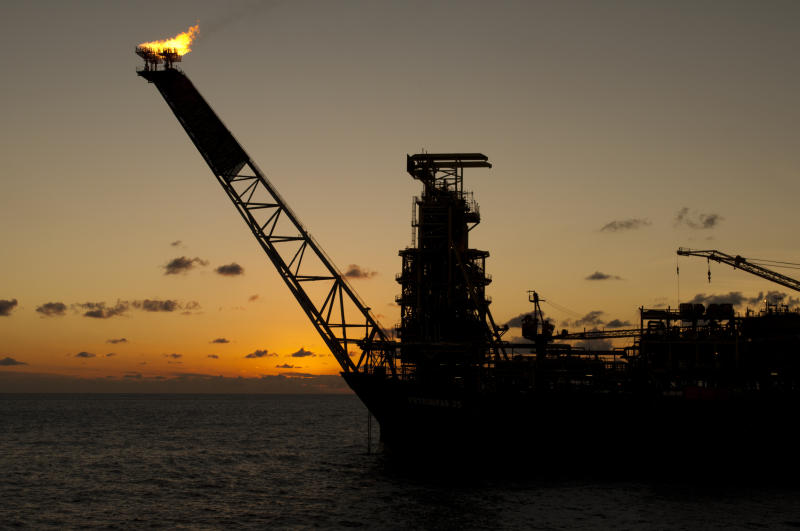 Offshore oil rig at sundown.