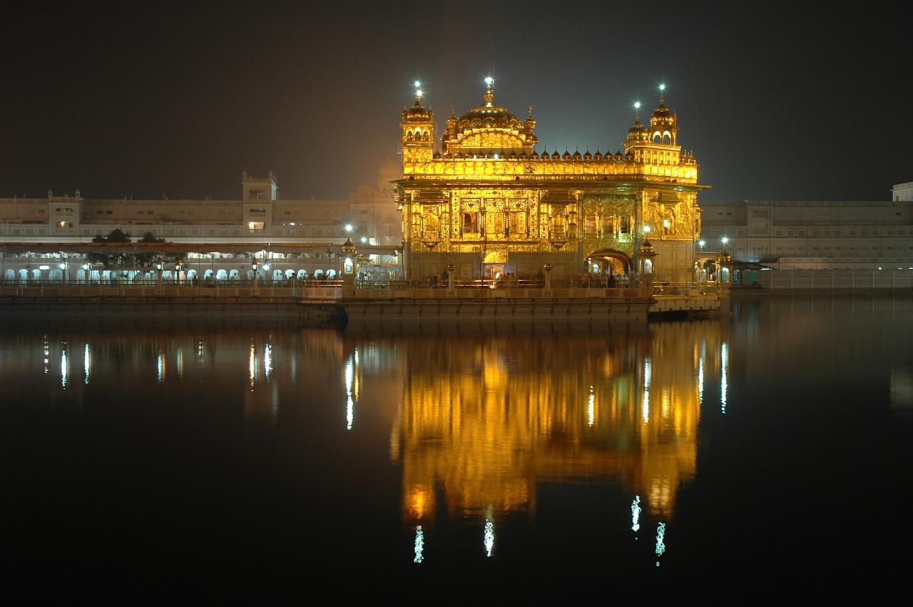 <p>Also known to Sikhs as Harminder Sahib, the temple is the most important religious place for the community and is seen as a symbol of brotherhood and equality. The architecture is a blend of Hindu and Muslim styles. The lower marble level has pietra dura work with animal and flower motifs, like that seen on the Taj Mahal. The second level has carved golden panels, and the temple is topped with a dome gilded in more than 700 kg of gold. The holy tank surrounding the temple is called Amrit Sarovar, from which the city gets its name. The work on the tank started in 1577. Every day over one lakh people from all over the world visit the Golden Temple, eat in the langar and take a dip in the holy tank that is said to have healing powers.<br /> Photograph: Prashant Ram/Flickr </p>