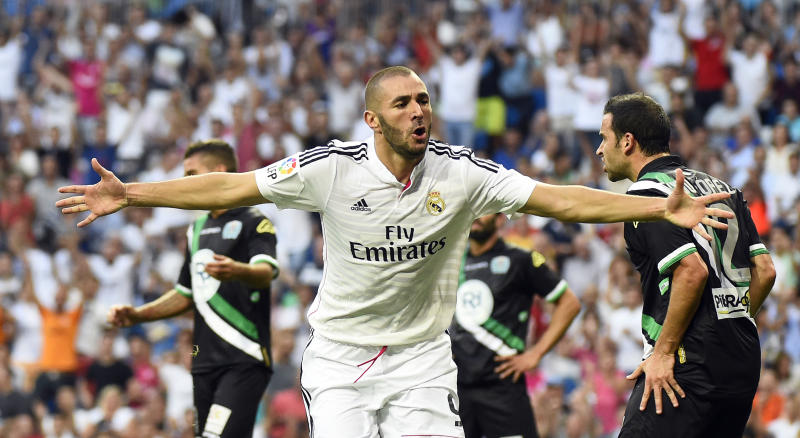 Real Madrid's Karim Benzema celebrates after scoring during the Spanish league match against Cordoba at the Santiago Bernabeu stadium in Madrid, on August 25, 2014 (AFP Photo/Gerard Julien )
