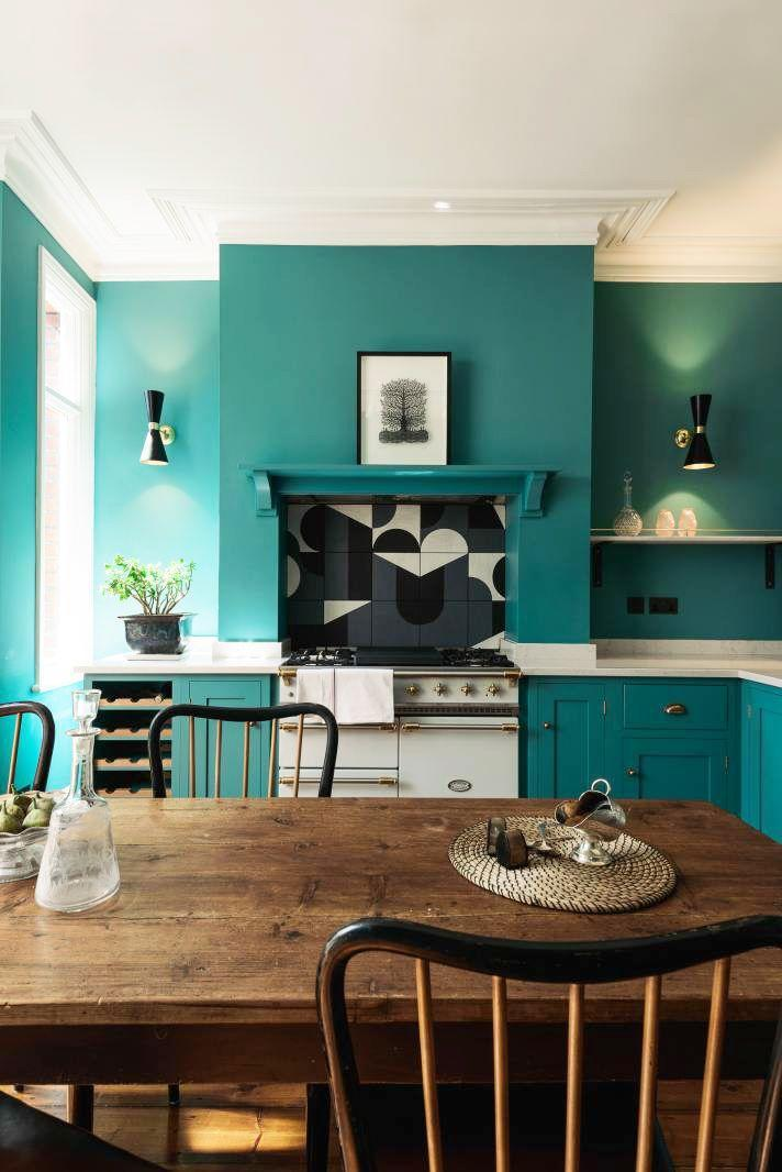 <p>When it comes to a backsplash, let your imagination run wild. This eclectic turquoise deVOL kitchen gets a surge of graphic style from the artful backsplash. The retro appliances and farmhouse dining table maintain the homey feel. </p>