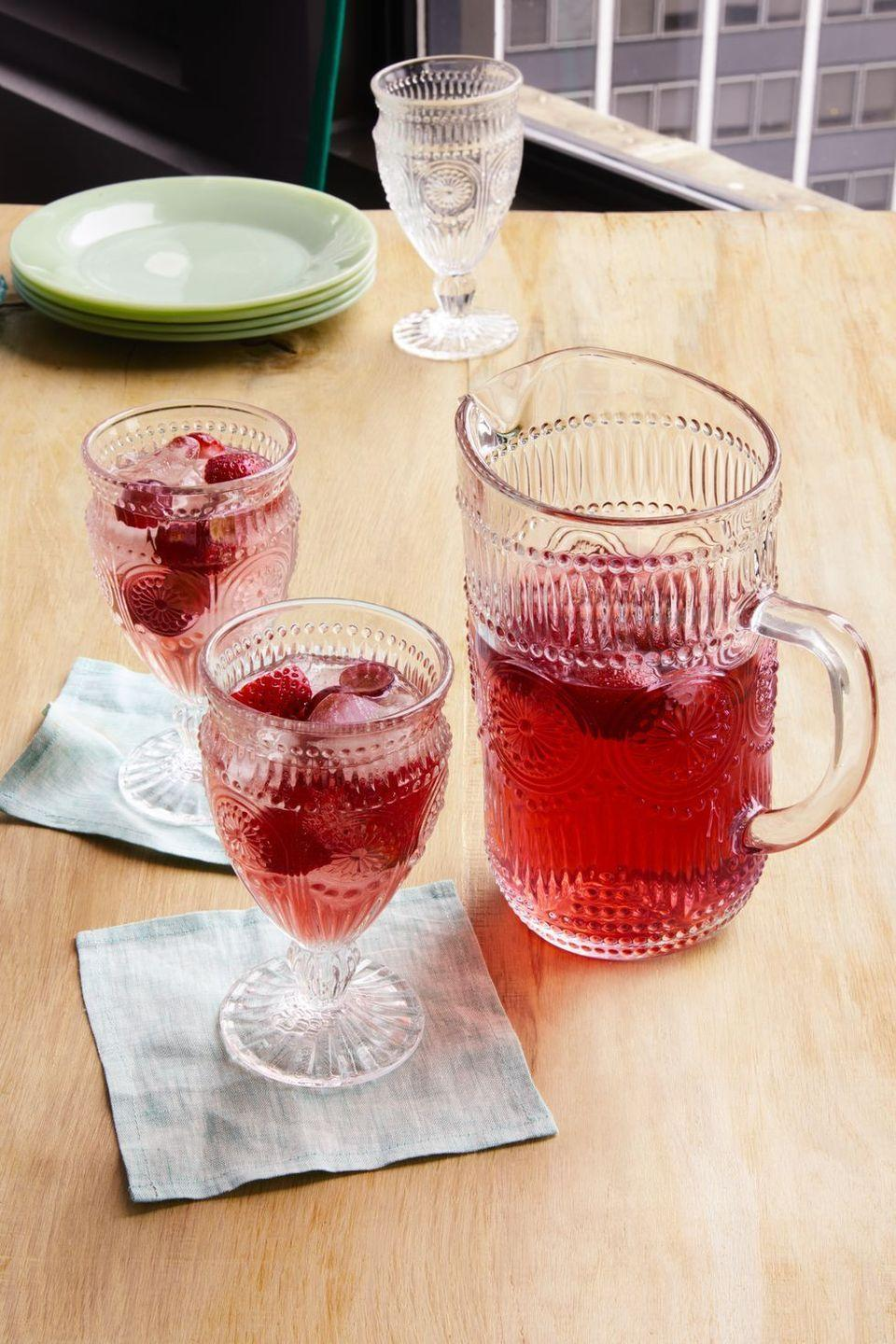 """<p>This strawberry sangria will quench your thirst in a sweet, satisfying way.</p><p><strong><a href=""""https://www.thepioneerwoman.com/food-cooking/recipes/a32304366/strawberry-sangria-recipe/"""" rel=""""nofollow noopener"""" target=""""_blank"""" data-ylk=""""slk:Get the recipe."""" class=""""link rapid-noclick-resp"""">Get the recipe.</a></strong></p><p><a class=""""link rapid-noclick-resp"""" href=""""https://go.redirectingat.com?id=74968X1596630&url=https%3A%2F%2Fwww.walmart.com%2Fsearch%2F%3Fquery%3Dpitchers&sref=https%3A%2F%2Fwww.thepioneerwoman.com%2Ffood-cooking%2Fmeals-menus%2Fg35585877%2Feaster-recipes%2F"""" rel=""""nofollow noopener"""" target=""""_blank"""" data-ylk=""""slk:SHOP PITCHERS"""">SHOP PITCHERS</a></p>"""