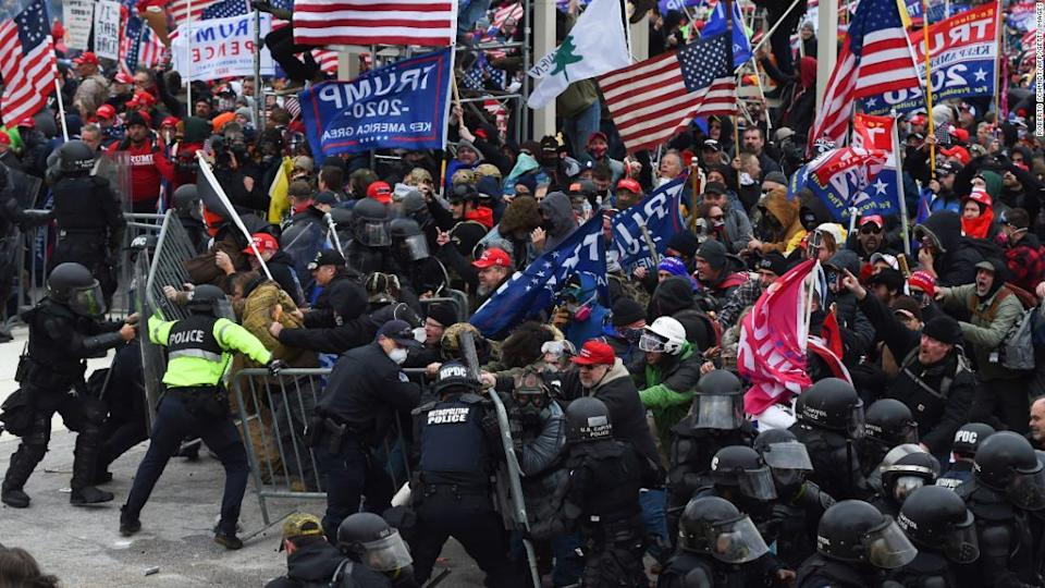 """<p>Trump supporters clash with police and security forces as they push barricades to storm the US Capitol in Washington on Wednesday, January 6.</p><div class=""""cnn--image__credit""""><em><small>Credit: Roberto Schmidt/AFP/Getty Images / Getty</small></em></div>"""