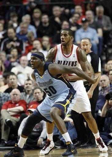 Memphis Grizzlies' Zach Randolph (50) defends Portland Trail Blazers' LaMarcus Aldridge, right, during the second quarter of an NBA basketball game Thursday, March 22, 2012, in Portland, Ore. (AP Photo/Rick Bowmer)