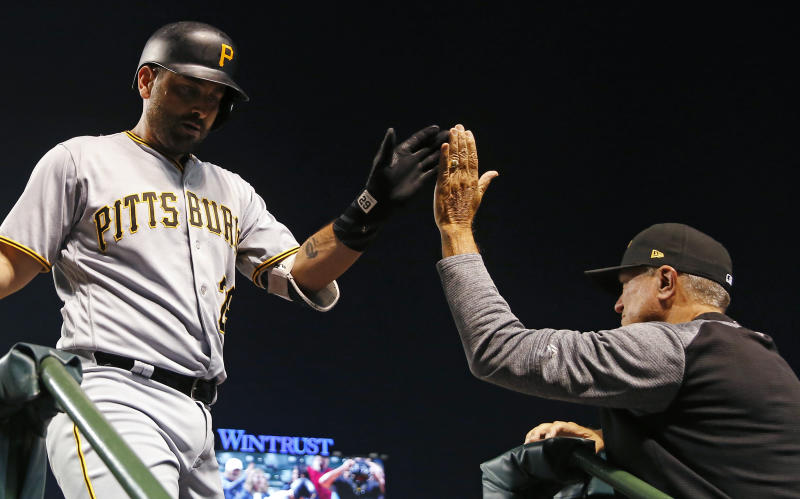 Pittsburgh Pirates' Francisco Cervelli, left, celebrates his two-run home run against the Chicago Cubs during the first inning of a baseball game Monday, Sept. 24, 2018, in Chicago. (AP Photo/Jim Young)