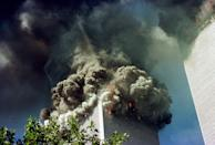 <p>The south tower of the World Trade Center collapses September 11, 2001 in New York City. (Getty)</p>