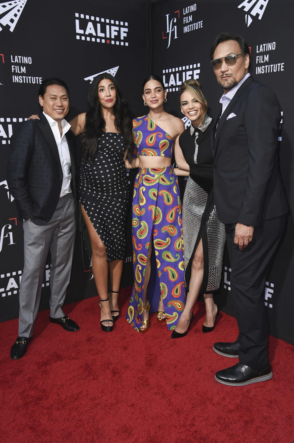 """Jon M. Chu, Stephanie Beatriz, Melissa Barrera, Leslie Grace and Jimmy Smits, form left, arrive at a screening of """"In the Heights"""" during the Los Angeles Latino International Film Festival at TCL Chinese Theatre on Friday, June 4, 2021, in Los Angeles. (Photo by Richard Shotwell/Invision/AP)"""