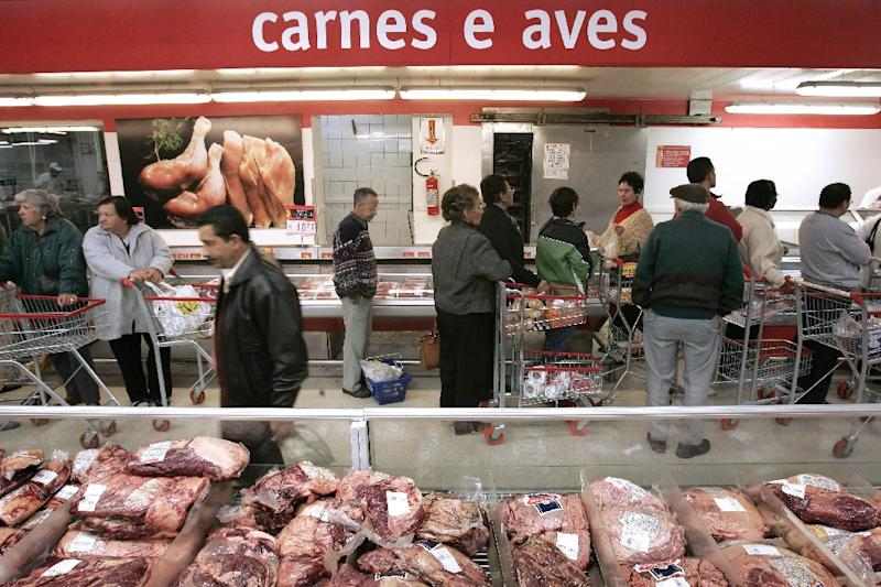 The world's largest meat packer, Brazil's JBS, has agreed to buy Moy Park, the UK unit of Marfrig Global Foods, for $1.5 billion (AFP Photo/Mauricio Lima)