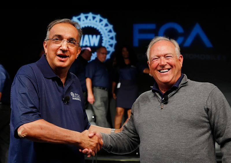 Fiat Chrysler Automobiles CEO Sergio Marchionne, left, and United Auto Workers President Dennis Williams shake hands during a ceremony to mark the opening of contract negotiations in Detroit in 2015.