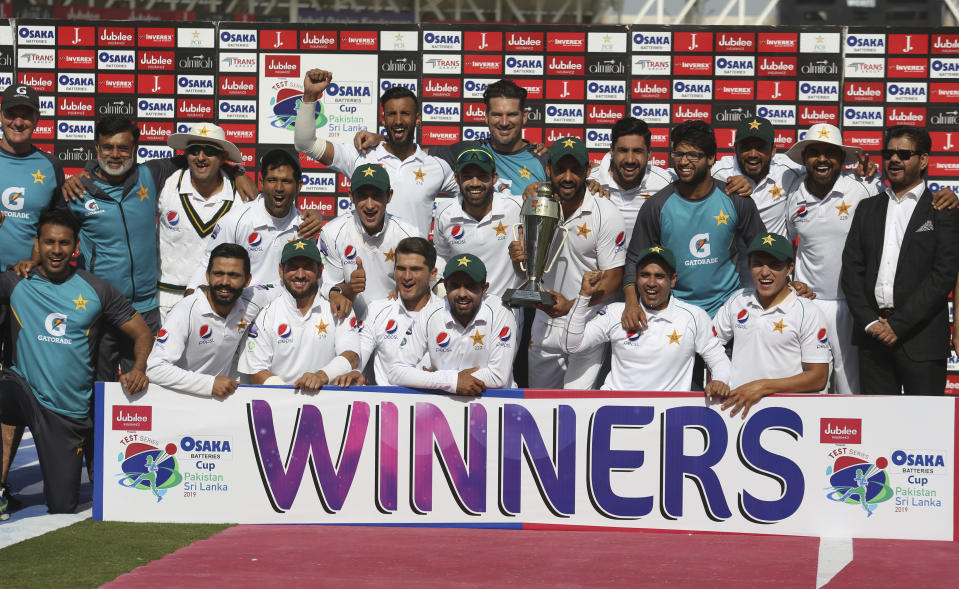 Players of Pakistan cricket team celebrate their victory against Sri Lanka in the second test in Karachi, Pakistan, Monday, Dec. 23, 2019. Pakistan completed a winning comeback to tests on home soil with a 1-0 series victory over Sri Lanka on Monday. (AP Photo/Fareed Khan)