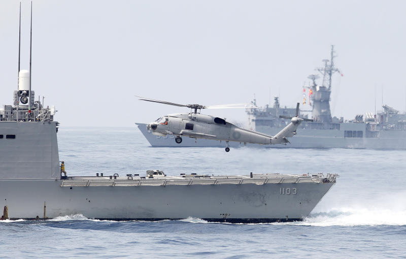 Photo shows Taiwan Navy S70 helicopter taking off from the stern of a Perry-class frigate.