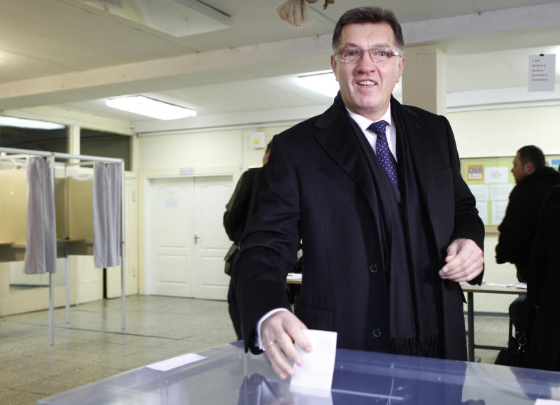 Social Democrat party leader Algirdas Butkevicius casts his vote at a polling station in Vilnius, Lithuania, Sunday, Oct. 28, 2012. Lithuanians balloted Sunday in a second -  round of parliamentary elections.  (AP Photo/Mindaugas Kulbis)