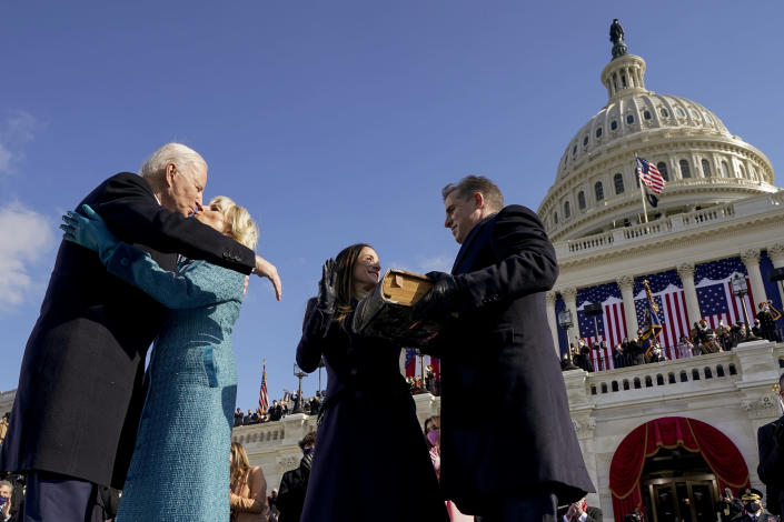 President Joe Biden and first lady Jill Biden, kiss as his son Hunter Biden and daughter Ashley Biden look on after being sworn-in during the 59th Presidential Inauguration at the U.S. Capitol in Washington, Wednesday, Jan. 20, 2021. (AP Photo/Andrew Harnik, Pool)