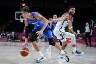 Czech Republic's Jan Vesely (24) drives past United States's Jayson Tatum (10) during a men's basketball preliminary round game at the 2020 Summer Olympics, Saturday, July 31, 2021, in Saitama, Japan. (AP Photo/Charlie Neibergall)