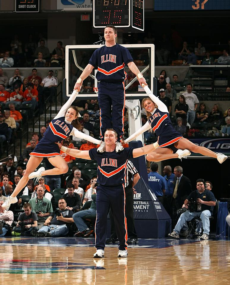 Cheerleaders for the Illinois Fighting Illini perform against the Purdue Boilermakers during their semifinal game of the Big Ten Men's Basketball Tournament at Conseco Fieldhouse on March 14, 2009 in Indianapolis, Indiana.  (Photo by Jonathan Daniel/Getty Images)