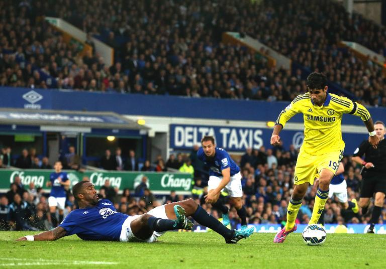 Chelsea's Brazilian-born Spanish striker Diego Costa (R) scores his team's sixth goal during the English Premier League football match between Everton and Chelsea at Goodison Park in Liverpool on August 30, 2014