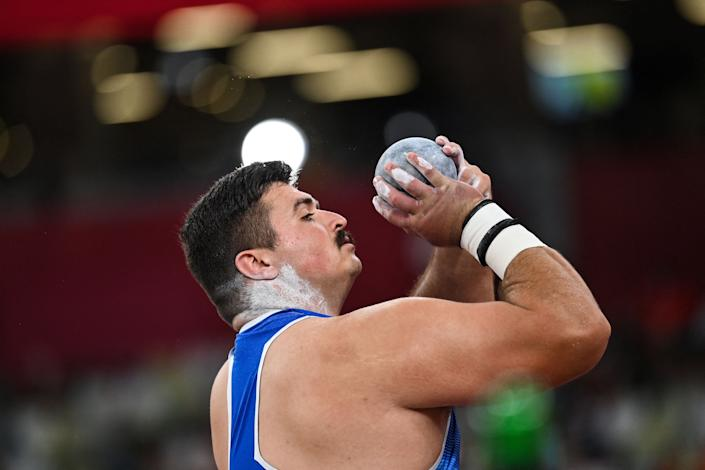 <p>Italy's Nicholas James Ponzio competes in the men's shot put qualification during the Tokyo 2020 Olympic Games at the Olympic Stadium in Tokyo on August 3, 2021. (Photo by Andrej ISAKOVIC / AFP) (Photo by ANDREJ ISAKOVIC/AFP via Getty Images)</p>