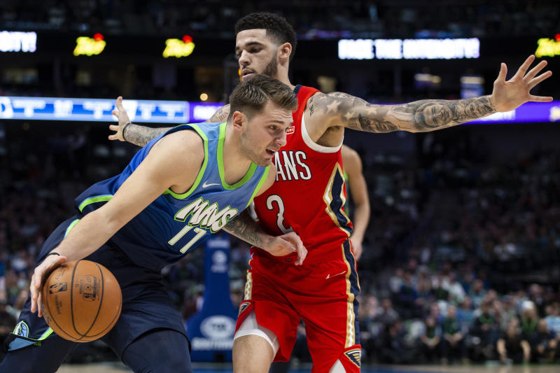 Dallas Mavericks forward Luka Doncic (77) dribbles the ball as New Orleans Pelicans guard Lonzo Ball (2) defends during the first quarter of an NBA basketball game Saturday, Dec. 7, 2019 in Dallas. (AP Photo/Sam Hodde)