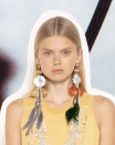 <p>Make an entrance in a pair of shoulder-grazing earrings. Whether for day or black tie, these earrings are more versatile than you'd think.<em><br></em></p><p><em>JW Anderson</em></p>