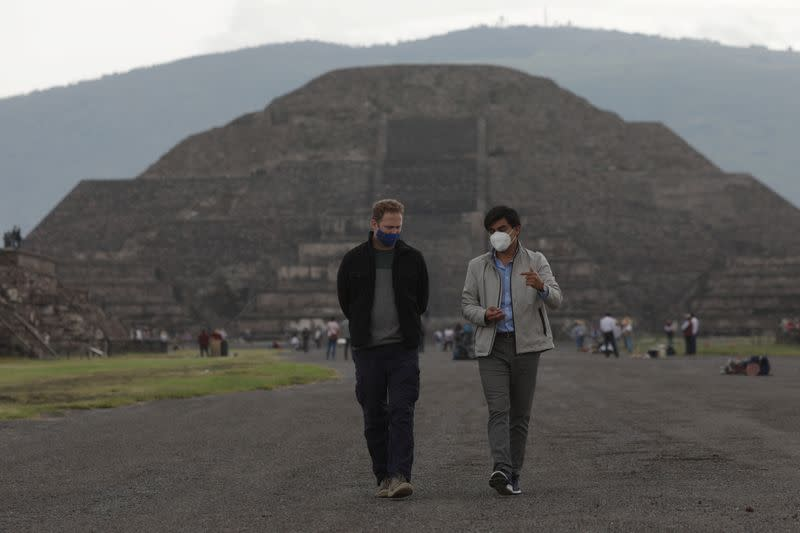 Visitors walk as they wear protective masks during the start of the gradual reopening of the ancient ruins of Teotihuacan