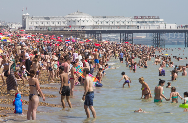 Thousands are flocking to the beach as the sun continues to bake Britain (Rex)