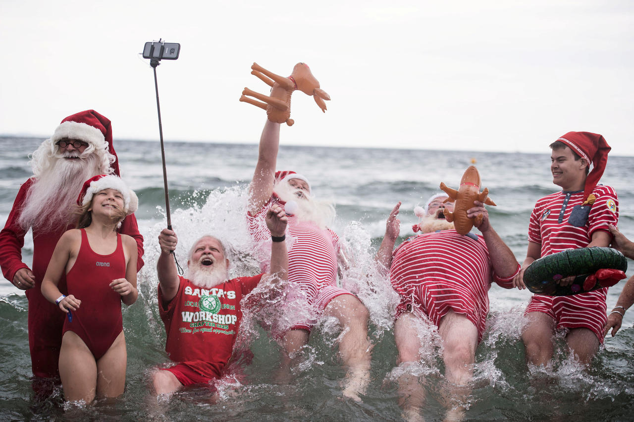 People dressed as Santa Claus bathe in the sea as they take part in the World Santa Claus Congress, an annual event held every summer at the amusement park Dyrehavsbakken, in Copenhagen, Denmark. Scanpix Denmark/Sarah Christine Noergaard/via REUTERS    ATTENTION EDITORS - THIS IMAGE WAS PROVIDED BY A THIRD PARTY. DENMARK OUT. NO COMMERCIAL OR EDITORIAL SALES IN DENMARK. NO COMMERCIAL SALES.     TPX IMAGES OF THE DAY