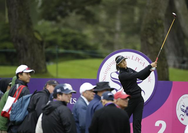 Michelle Wie follows her drive from the second tee of the Lake Merced Golf Club during the second round of the Swinging Skirts LPGA Classic golf tournament Friday, April 25, 2014, in Daly City, Calif. (AP Photo/Eric Risberg)