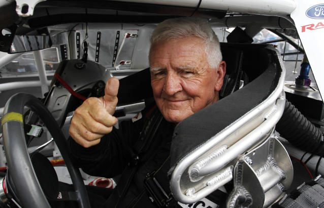 ARCA driver James Hylton gives a thumbs up while sitting in his race car during practice at Kansas Speedway in Kansas City, Kan., Friday, Oct. 4, 2013. The 79-year-old will retire following Friday's ARCA Kansas Lottery 98.9 race. (AP Photo/Colin E. Braley)