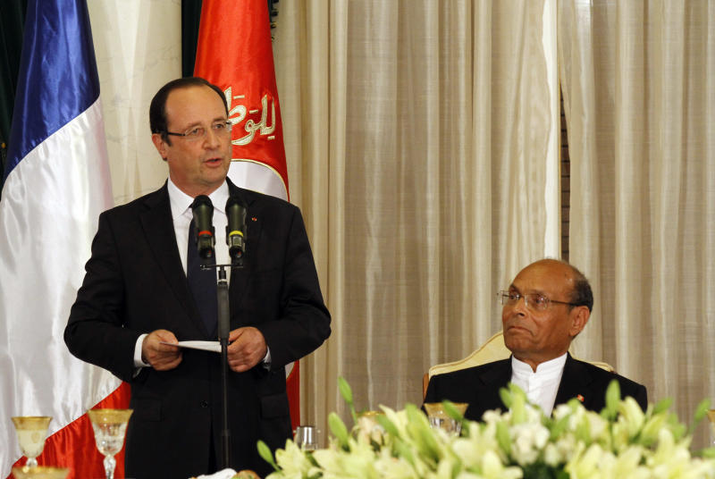 French President Francois Hollande, left, delivers a speech as Tunisian President Moncef Marzouki listens before the state dinner at the Carthage Palace in Tunis, Tunisia Thursday, July 4, 2013. (AP Photo/Anis Mili, Pool)