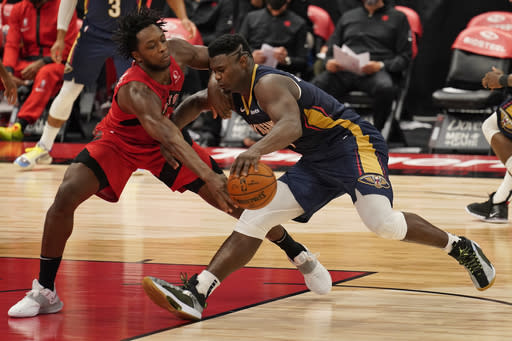 Toronto Raptors forward OG Anunoby (3) knocks the ball away from New Orleans Pelicans forward Zion Williamson (1) during the second half of an NBA basketball game Wednesday, Dec. 23, 2020, in Tampa, Fla. (AP Photo/Chris O'Meara)