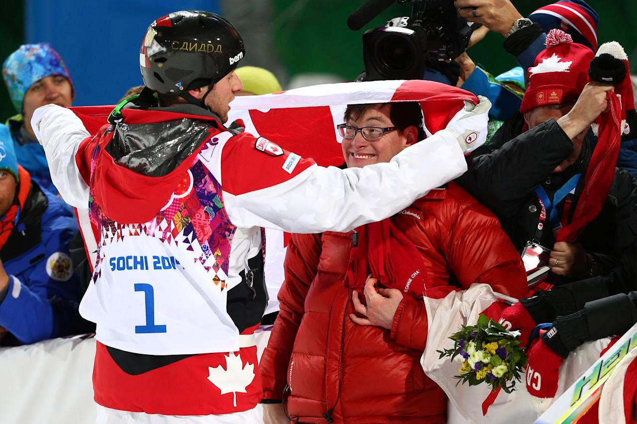 SOCHI, RUSSIA - FEBRUARY 10: Gold medalist Alex Bilodeau of Canada celebrates with his brother Frederic after the flower ceremony for the Men's Moguls Finals on day three of the Sochi 2014 Winter Olympics at Rosa Khutor Extreme Park on February 10, 2014 in Sochi, Russia. (Photo by Cameron Spencer/Getty Images)