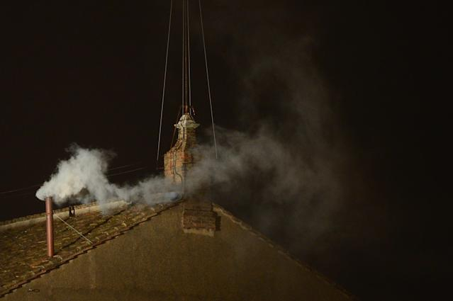 VATICAN CITY, VATICAN - MARCH 13: White smoke billows from the chimney on the roof of the Sistine Chapel indicating that the College of Cardinals have elected a new Pope on March 13, 2013 in Vatican City, Vatican. Pope Benedict XVI's successor, the 266th Pontiff, has been selected by the College of Cardinals in Conclave in the Sistine Chapel. (Photo by Jeff J Mitchell/Getty Images)