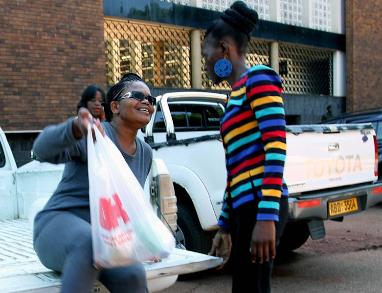 Human rights lawyer, Beatrice Mtetwa, left, arrives at court in Harare, Tuesday, March 19, 2013. Police have charged Mtetwa for obstructing justice after ignoring a judge's order to release her a day earlier. Mtetwa was arrested Sunday while representing four opposition members of the prime minister's party while undergoing police searches. (AP Photo)