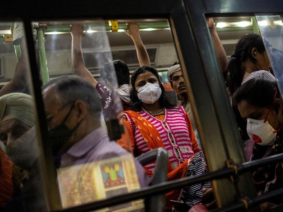 Commuters travel in a crowded bus during evening rush hour, in New Delhi, India, on March 18, 2020.