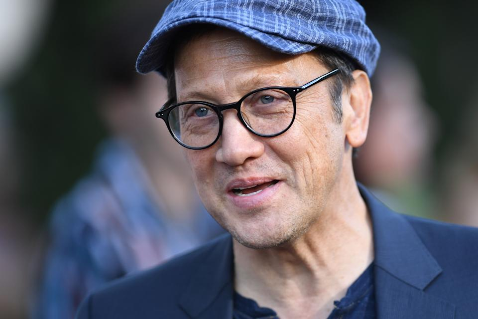 """US actor Rob Schneider arrives to attend the Los Angeles premiere screening of the Netflix film """"Murder Mystery"""" at the Regency Village Theatre in Los Angeles on June 10, 2019. (Photo by VALERIE MACON / AFP)        (Photo credit should read VALERIE MACON/AFP via Getty Images)"""